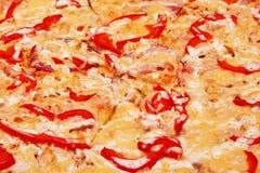 Pizza (sausage, ham, chicken fillet, paprika) Stock Photo