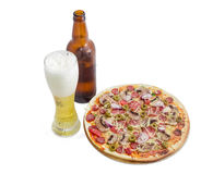 Pizza with sausage and lager beer on a light background Royalty Free Stock Photography