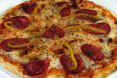 Pizza with sausage and pepper, large. Hot pizza with sausage, pepper and cheese Royalty Free Stock Photography