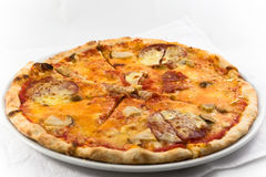 Pizza with sausages. Isolated pizza with sausages and mushrooms Royalty Free Stock Image