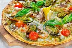 Pizza. With seafood on the board Stock Photo