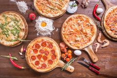 Pizza with seafood and cheese, pepperoni stock photos