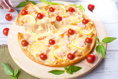 Pizza with seafood red fish, salmon, shrimp, tomatoes, still life, cheese, stretches, shoulder, slice, rises Stock Photos