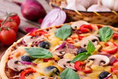 Pizza with seafood on wood table Stock Photo