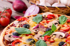 Pizza with seafood on wood table Royalty Free Stock Image