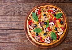 Pizza with seafood on wood table top view Stock Photos