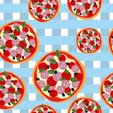 Pizza seamless pattern on a blue tablecloth. Food background Stock Photos