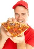 Pizza in seinen Händen stockbild