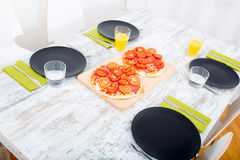 Pizza served on wooden table Stock Images