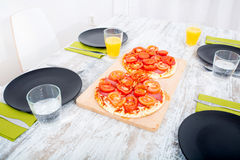 Pizza served on wooden table Stock Image