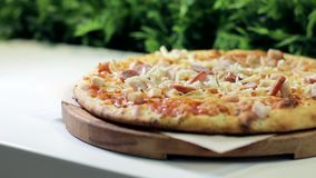 Pizza serving in a cafe close-up stock video