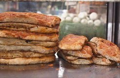 Pizza sfincione. Sicilian traditional pizza sfincione at historic market of palermo Royalty Free Stock Images