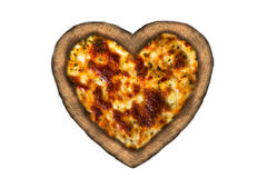 Pizza in the shape of a heart. Isolated on white background Stock Photography