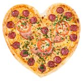 Pizza in the shape of a heart with tomatoes, ham and salami spri Royalty Free Stock Images