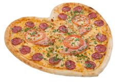 Pizza in the shape of a heart with tomatoes, ham and salami spri. Nkling of fresh herbs on the Chroma key Royalty Free Stock Photos