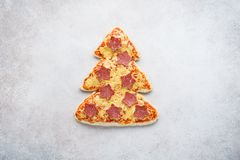 Free Pizza Shaped As Christmas Tree With Stars Made Of Pepperoni Royalty Free Stock Images - 162027039