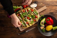 Pizza with shiitake chicken and vegetables on the wooden background stock photos