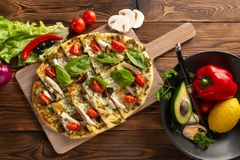 Pizza with shiitake chicken and vegetables on the wooden background royalty free stock photo