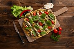Pizza with shiitake chicken and vegetables on the wooden background royalty free stock photos