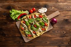 Pizza with shiitake chicken and vegetables on the wooden background stock images
