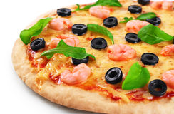 Pizza with shrimp olives and arugula on a white background. Royalty Free Stock Image