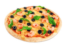 Pizza with shrimp olives and arugula on a white background. Royalty Free Stock Photos