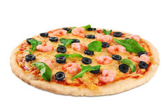 Pizza with shrimp olives and arugula on a white background. Royalty Free Stock Photo