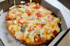 Pizza. Shrimp pizza recipe in the box Stock Photos
