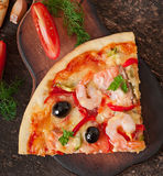 Pizza with shrimp, salmon and olives Royalty Free Stock Image