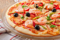 Pizza with shrimp, salmon and olives Stock Photo