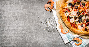 Pizza with shrimp, tomato paste and olive oil. Stock Images