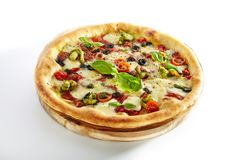 Pizza with Shrimps, Kalamata Olives, Tomato Sauce Isolated. Pizza with Shrimps, Kalamata Olives, Tomato Sauce, Pesto, Mozzarella Cheese, Fresh Basil, Cherry royalty free stock images