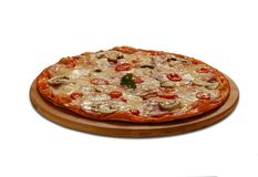 Pizza siciliana with ham, tomatoes, mushrooms and mozzarella. On Royalty Free Stock Photos