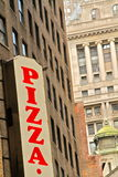Pizza sign. Banner against urban background Royalty Free Stock Images
