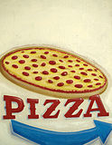 Pizza Sign. A rustic, distressed, hand painted sign for pizza with an arrow showing which way to go for ordering Royalty Free Stock Photo