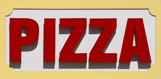 Pizza Sign. Restaurant sign advertising pizza. This was a large sign associated with a restaurant on a boardwalk Stock Photo
