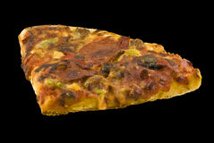 Pizza Slice. Isolated on a black background royalty free stock photo