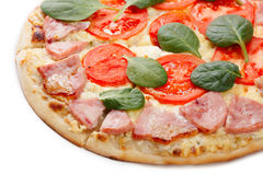 Pizza slice close up. Close up of sliced pizza with chicken, meat and gherkins stock photo