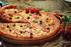 Pizza with a slice cut Royalty Free Stock Photo