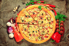 Pizza with a slice cut, delicious pastries Stock Photos