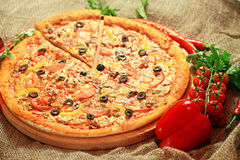 Pizza with a slice cut, delicious pastries Royalty Free Stock Photography