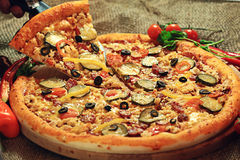 Pizza with a slice cut Royalty Free Stock Image