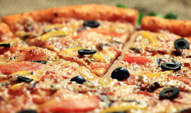 Pizza with a slice cut Royalty Free Stock Images