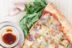 Pizza slice with ingredients. Pizza slice with garlic, fennel and balsamic sauce, top view Stock Photo