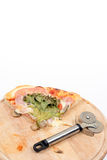 Pizza slice with lettuce and tomato and copy space over white background Stock Photos