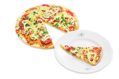 Pizza and a slice of pizza on a plate Royalty Free Stock Photography