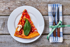 Pizza slice on a plate. Royalty Free Stock Image