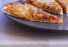 Pizza slice on a plate. Image of Margherita Pizza from Italy on a plate with a cheesy topping royalty free stock image
