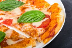 Pizza with slice on the plate royalty free stock images