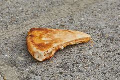 Pizza slice on a plate. Pizza slice dropped on the ground stock photography